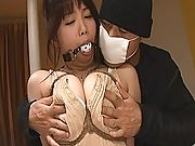 Asian slut is trussed like a gagged turkey and her tits are jizzed on
