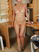 Blonde workplace MILF shows off her 55 yr old super hot body below