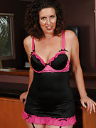 45 year old Tammy Sue posing in and out of sexy black color lingerie