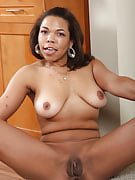 Ebony MILF Rena promptly peels her tight clothing in the kitchen
