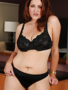 Horny redheaded Ryan slips off this girl stylish outfit and poses nude