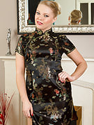 Exotic and stylish appearing Abi Toyne slips a glass vibrator deep inside