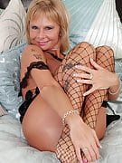 Old pornstar Cathy Oakley in black colored fishnet stocking show her burger