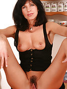Tight bodied adult brunette enjoys her rubber buddy