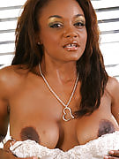 Ebony MILF along with sensuous boobies growing her legs here