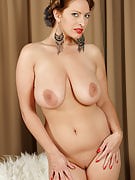 Refined and busty Salinas from 30 plus Ladies spreads her shaven pussy