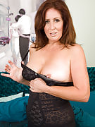 Beautiful Carol Foxwell slips away the lady black lingerie in order to wear a display