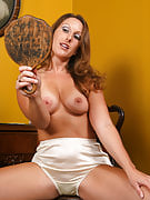 Brunette MILF Charlie from 30 plus Ladies posing together with her mirror in below