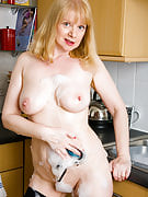 52 yr old Amanda having fun using the bubbles and tits as part of there