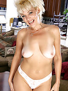 Spicey golden-haired MILF has fun showing away her ideal anatomy