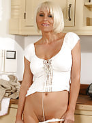 Hot housewife Jan strips away her clothing while doing her chores