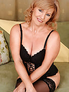 Gorgeous 57 yr old Lena F slips from the lady slinky lingerie in order to pose