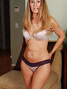 Hot golden-haired housewife Sara J strips and additionally pinches the lady perky nipples