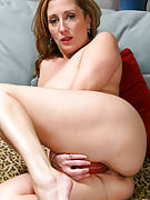 Big titted MILF alongside the shaven pussy toys her shaven hole as part of here