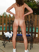 After playing tennis the wife cools off by getting naked