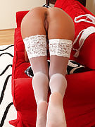 36 year old Sandy K posing and also spreads comfortable as part of white lacey stocking