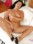 Hot mature brunette Laura from 30 plus Ladies as part of denim and black colored thong