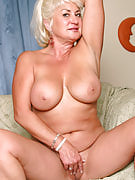 MILF with big plump boobs speads her mature crotch for us