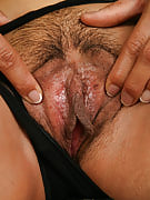 Spicy brunette Dez spreads the lady furry but neat vagina in the couch