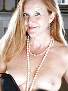 Elegant redheaded MILF Michelle M growing the lady long long thighs