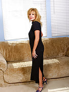 Elegant Arowyn slips off her black dress and additionally poses as part of here