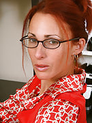Slim redheaded MILF Skyla strips and also spreads at the office