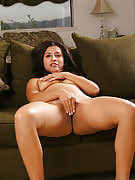 Exotic Angel plays with her spicy pussy regarding the sofa
