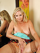 55 year older Annabelle posing inside her red hot thongs and stockings