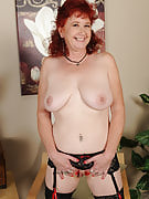 Popular adult redhead clearly as part of knee high stockings spreads wide