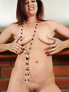 Elegant and gorgeous Xena wearing long nothing and drops otherwise looks awesome