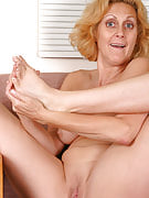Golden-haired MILF plays using the her feet and her vagina for us
