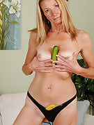 56 year old housewife Pam jams the banana into her finely aged vagina